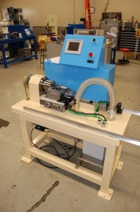 Bench style CNC cutoff machine in production