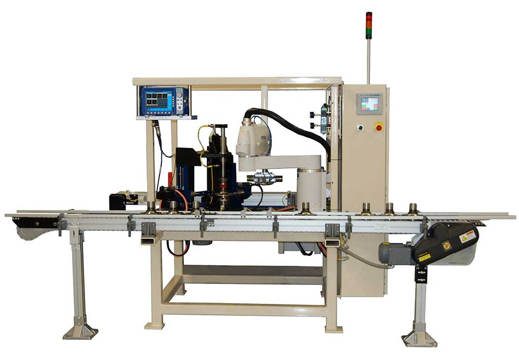 Machine that tests automotive spindles for surface cracks using eddy current probes