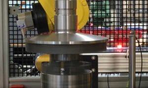 Transmission shaft being inspected by robots with eddy current probes